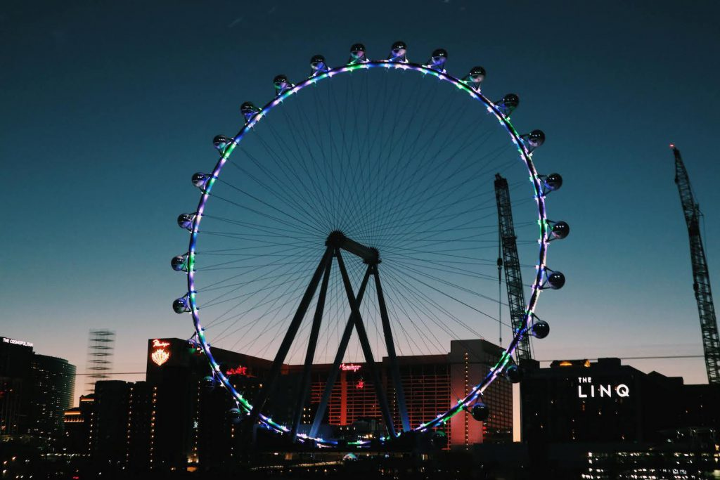 the 550-foot tall high roller wheel at the linq in las vegas lit up at sunset