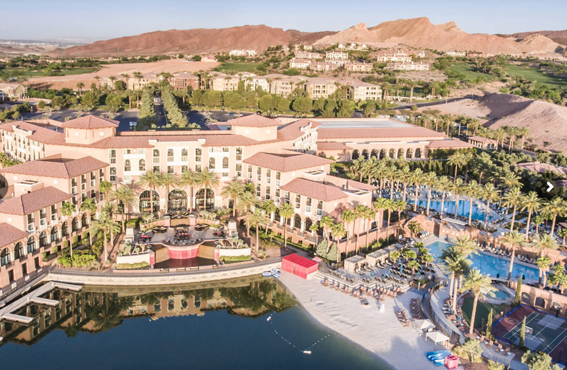 a small beach, kayaks, pool, and water of lake las vegas bordering the westin hotel