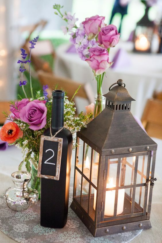 lantern and flowers arranged on a wedding reception table