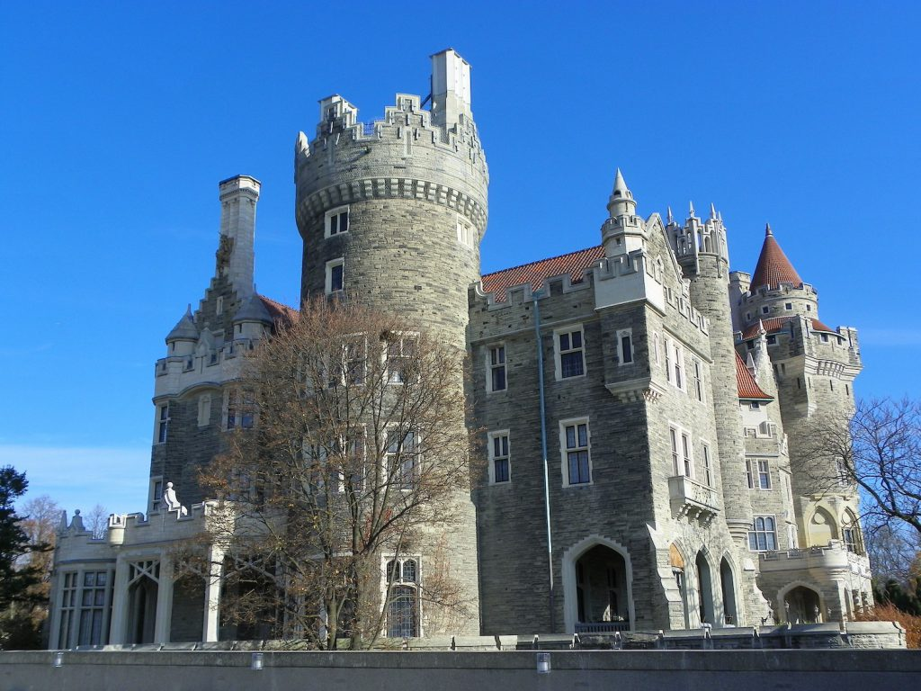 exterior of casa loma castle under a blue sky in toronto