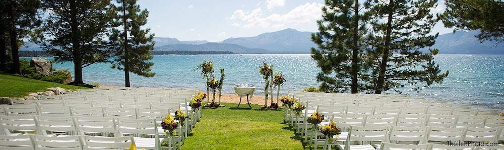 white chairs and floral displays set for a wedding reception on the shore of lake tahoe at the edgewood tahoe