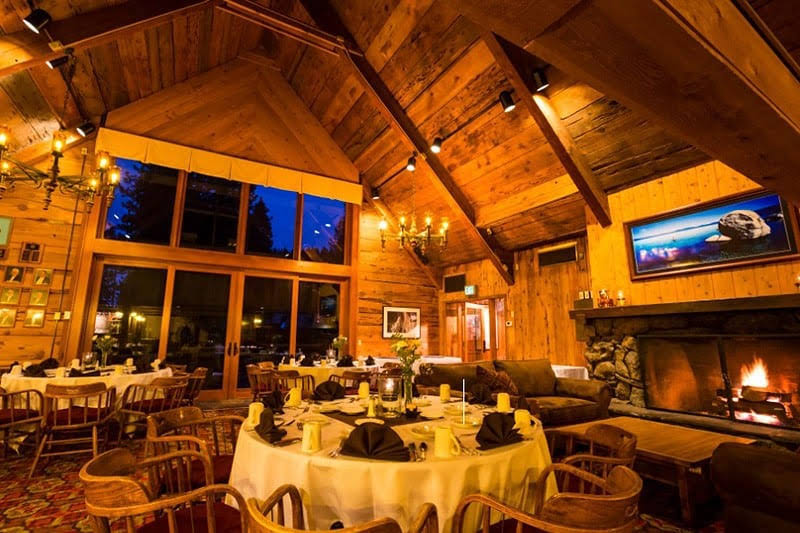 the glowing interior of the granlibakken tahoe that's set for a wedding reception