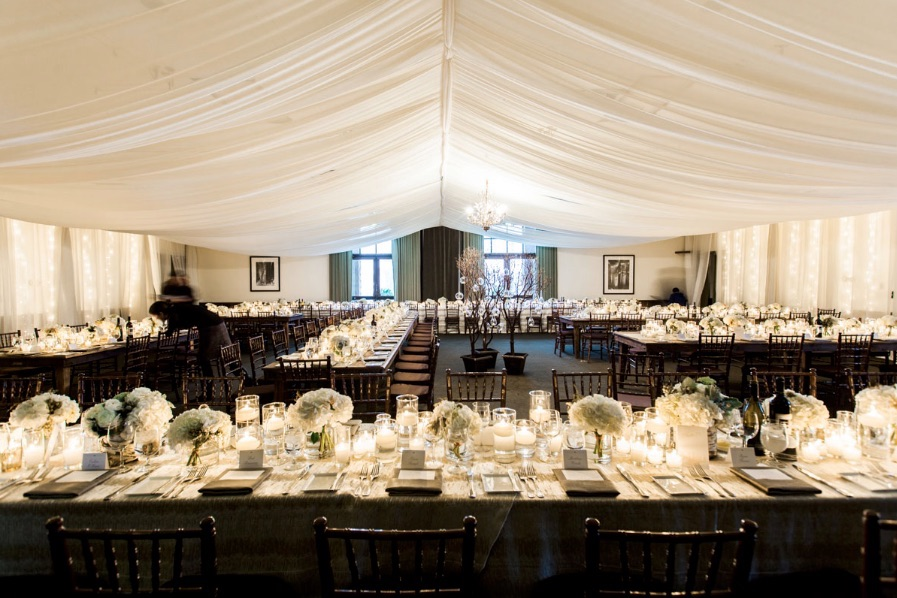the lodge at plumpjack squaw valley inn set for a wedding reception with white decor