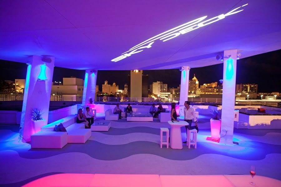 Skydeck Rooftop Miami wedding venue lit up with purple light at night