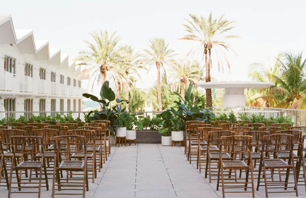 wooden chairs set up for a ceremony on the Sky Terrace at the Shelborne South Beach wedding venue in Miami