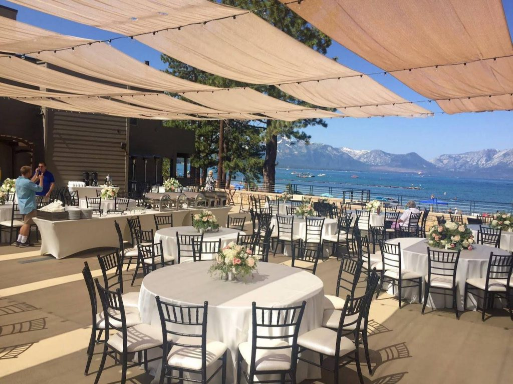 tables set for a wedding reception on the grand rooftop terrace at the landing resort & spa in lake tahoe