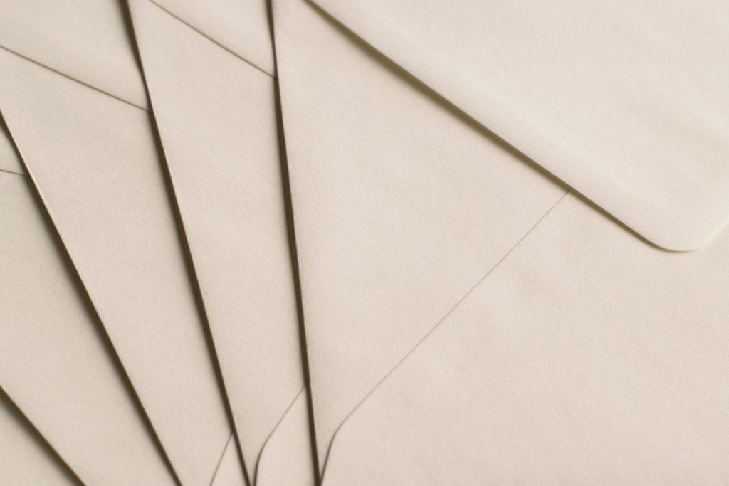 overlapping beige envelopes