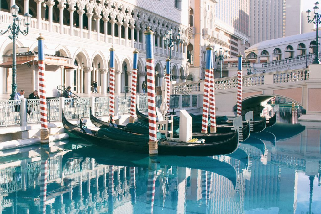 gondolas lined up at the venetian canal in las vegas