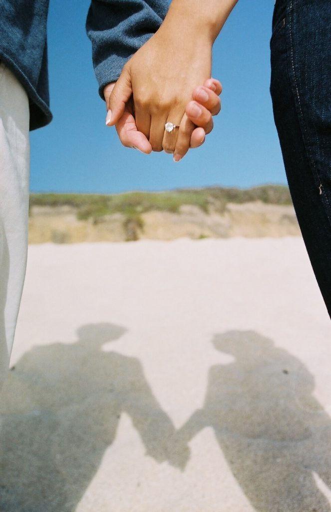 bring your ring into focus summer engagement photo idea