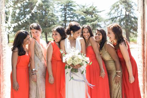 a group of women in dresses