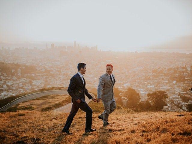 two men walking on a hill
