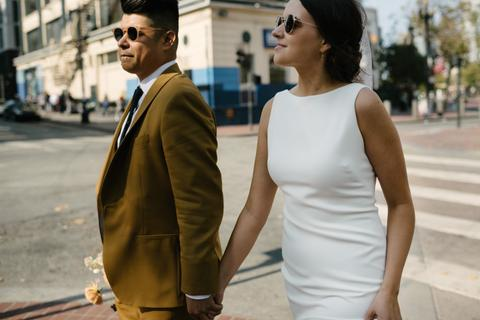 a man and woman walking on a street